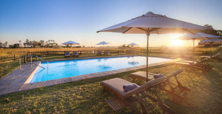 Sun loungers surround the swimming pool at Eagle Island Lodge