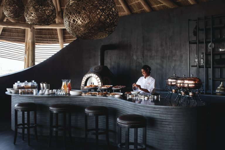 The stylish dining area with pizza oven at Eagle Island lodge