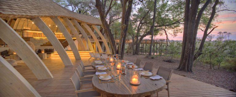 Dinner at Sandibe Safari Camp on wooden deck overlooking Delta