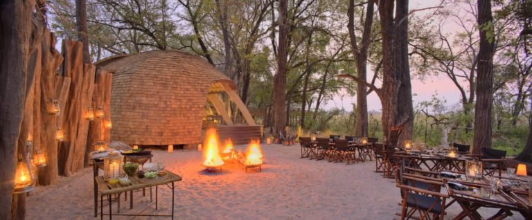 Traditional Sandibe boma dinners around a central fire are popular