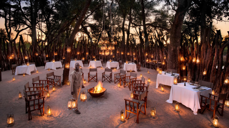 Dinner by lantern light in early evening in Nxabega's boma area
