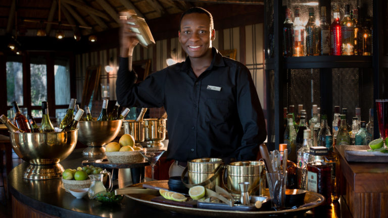 Cocktails with a welcome smile at Nxabega Tented Camp