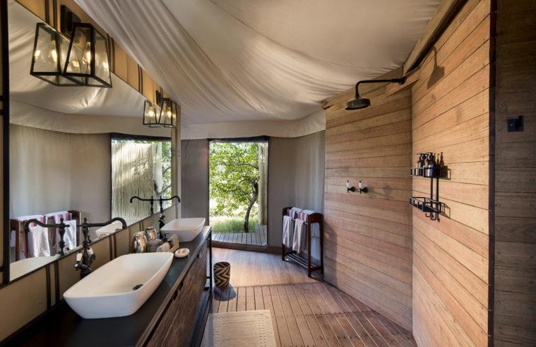 Exquisitely designed en suite bathrooms have both indoor and outdoor al fresco showers