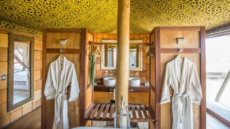 Ensuites bathrooms at &Beyond's Xaranna Okavango Delta Camp spoil guests with indoor bathtubs and al fresco showers