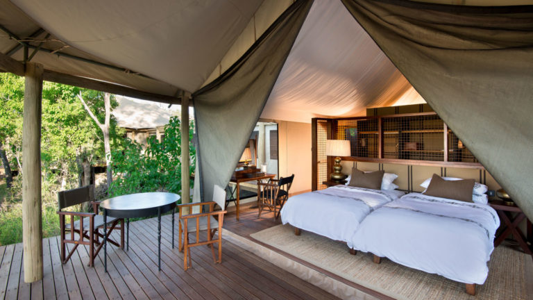 Nxabega camp's spacious family tents consist of two interleading luxury tents combined