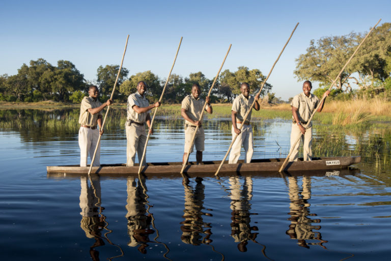 Professional Mokoro guides at Xaranna navigate through the reed lined water channels and lagoons with their guests