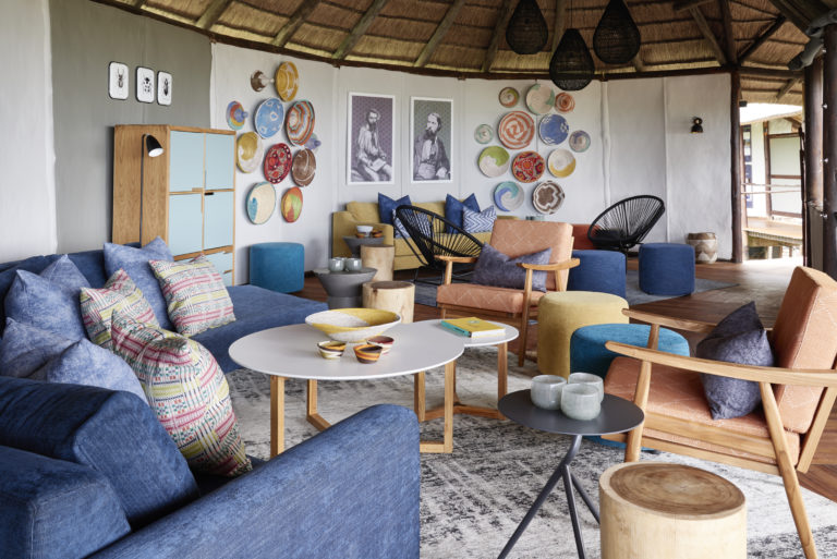 The stylish blue toned lounge area at Baines' Camp