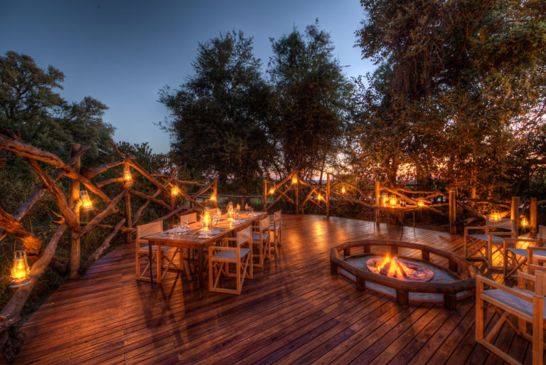 Dinner at dusk by candlelight is an intimate affair at Camp Moremi