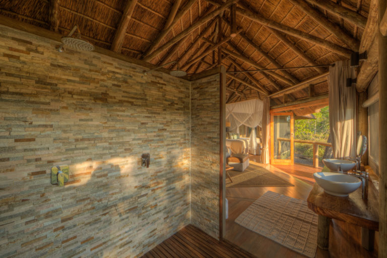Spacious bathrooms at Camp Moremi have twin basins and showers