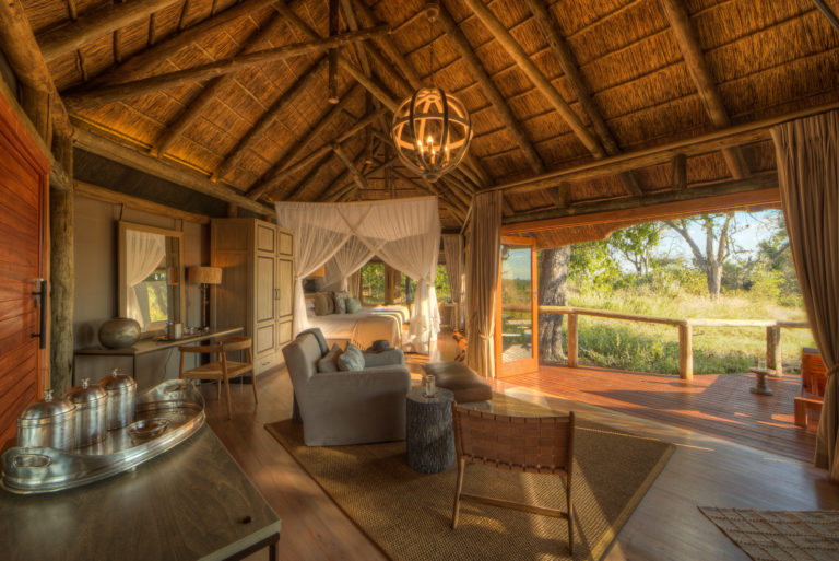 Moremi Camp's guest rooms blend in with the natural environment