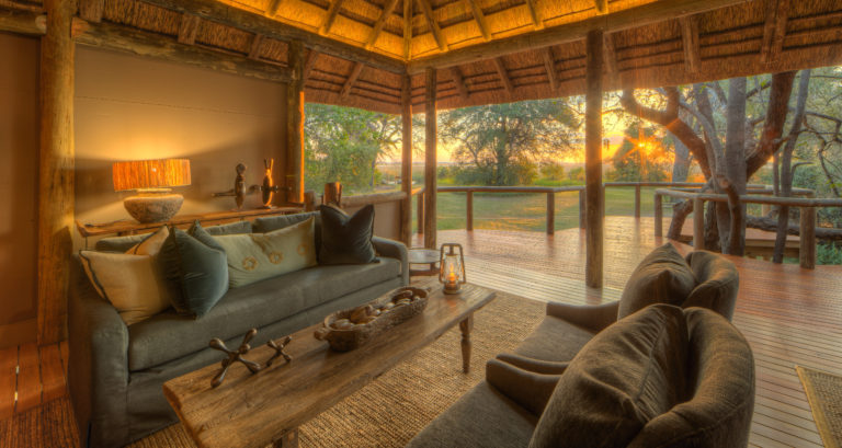 Relax in the spacious lounge at Camp Moremi