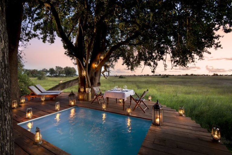 Private dining set up around pool at Duba Plains