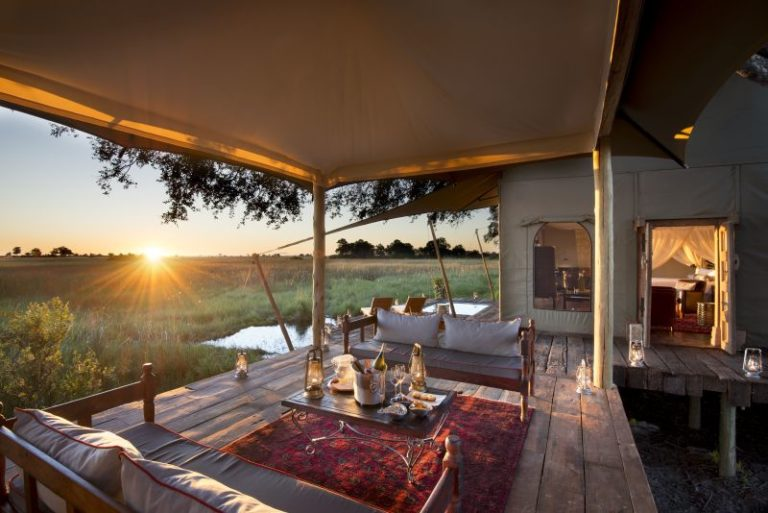 Sunset from private guest room deck at Duba Plains