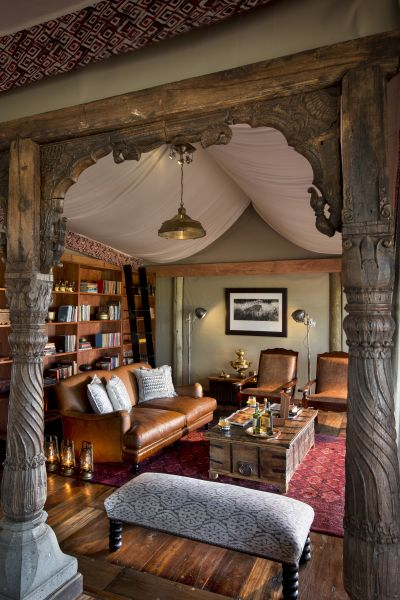A classically styled library corner with leather seating at Duba Plains