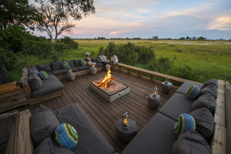 The beautiful outdoor sunken lounge and fire pit at Vumbura