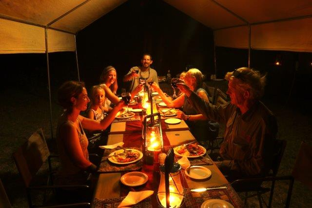 Communal dining tent table at dinnertime with Letaka Mobile Safaris