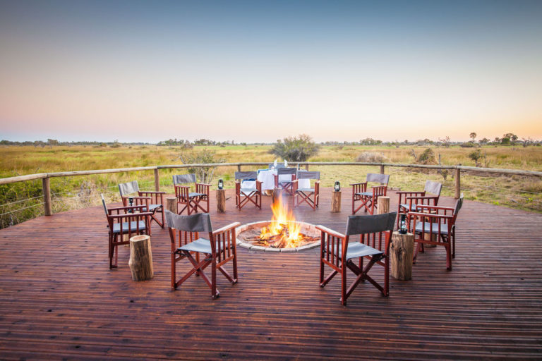 The firepit at Rra Dinare on wooden deck with guest seating