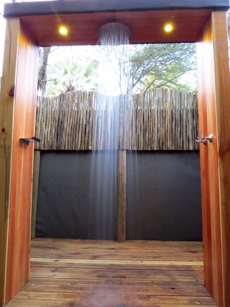 Luxury outdoor showers are attached to guest tents at Rra Dinare