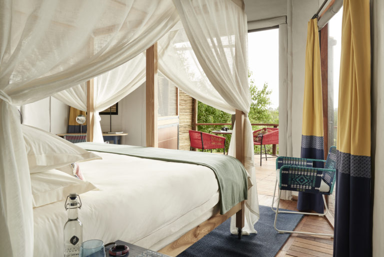Sanctuary Baines' Camp spacious guest bedrooms have a romantic feel
