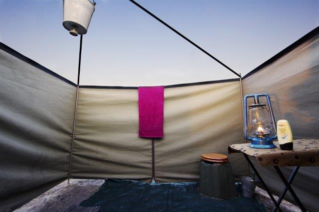 Guests enjoy authentic bucket showers on safaris with Letaka