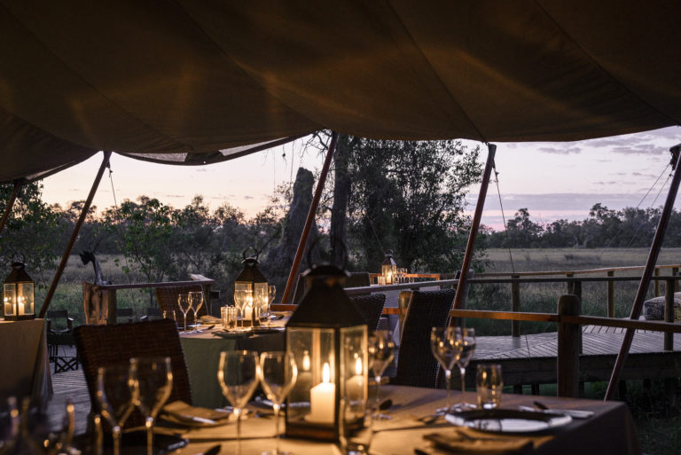 Dinner by lantern light at Sanctuary Stanley's Camp