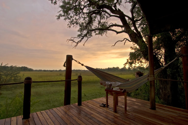 An African sunrise by hammock at Stanley's Camp