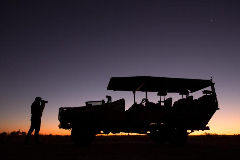 Silhouetted Letaka safari vehicle at twilight