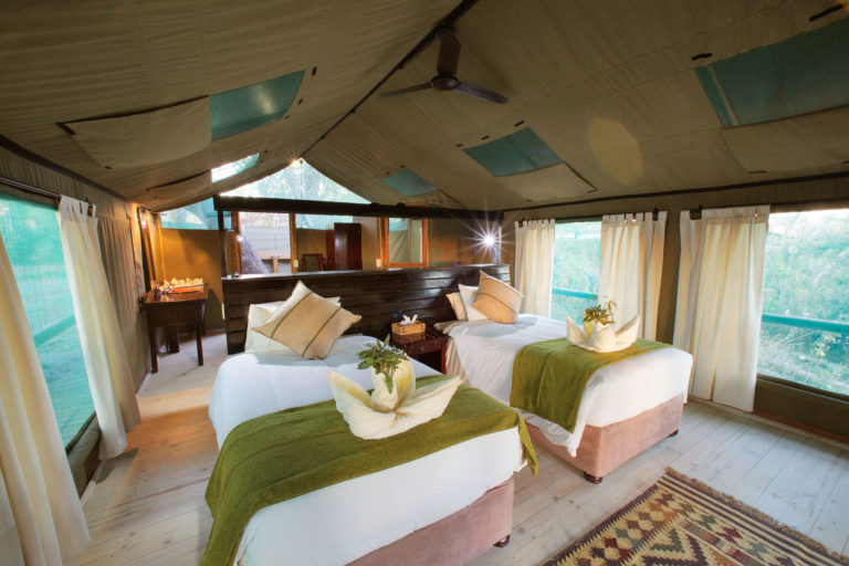 Layout and interior decor of furnished deluxe Meru tent at Gunn's Camp