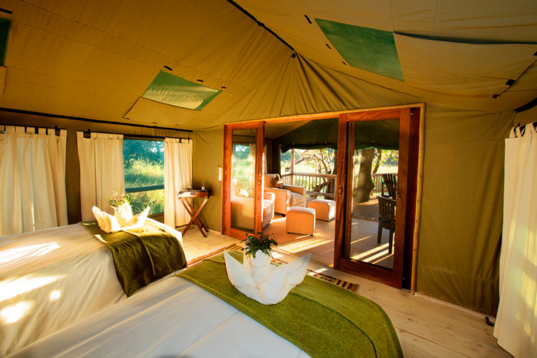 Guest tents at Gunn's Camp are styled with traditional African inspired furniture