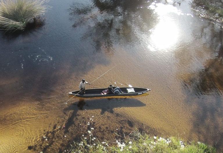 Mokoro shadow on the water at Gunn's Camp
