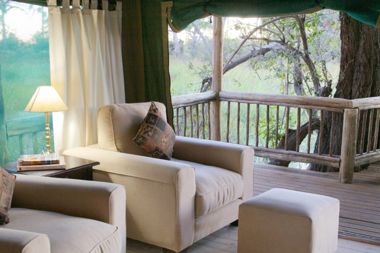 Tranquil corner in seating area of Gunn's Camp guest tent