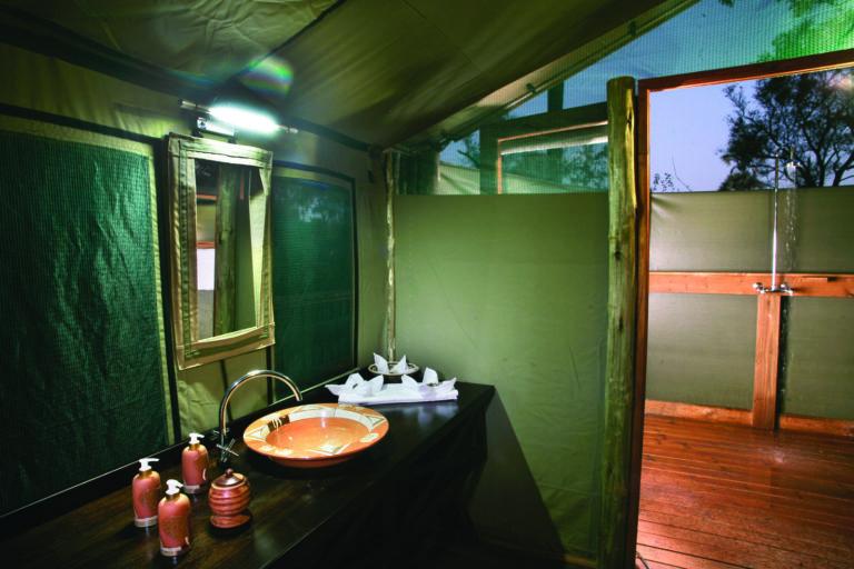 En suite bathroom of guest tent at Moremi Crossing