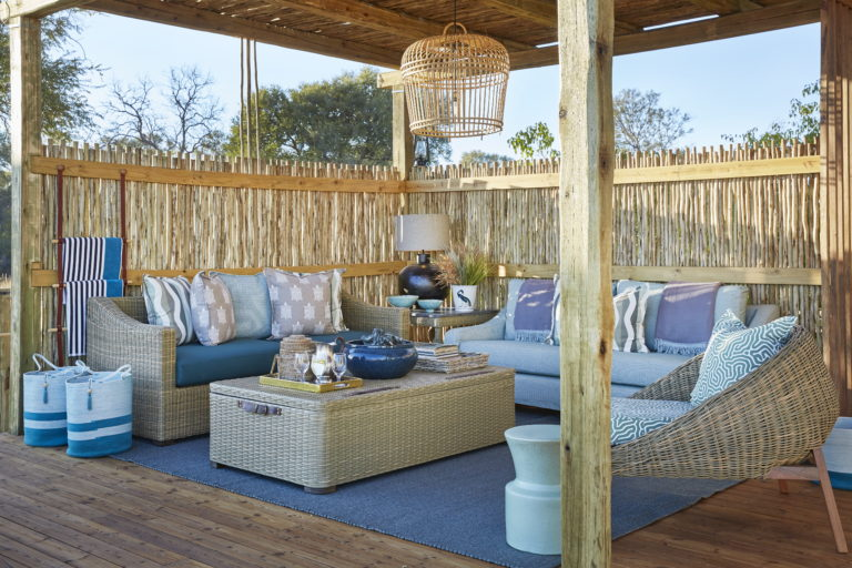 Tuludi camp's outdoor pavilion at swimming pool with comfortable seating