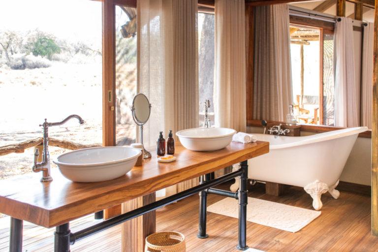 Elegant twin basins in en suite guest bathroom at Kwara Camp