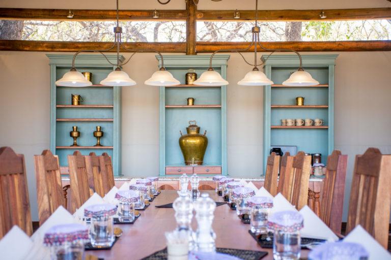 Scene of prepared dining room table at Kwara Camp