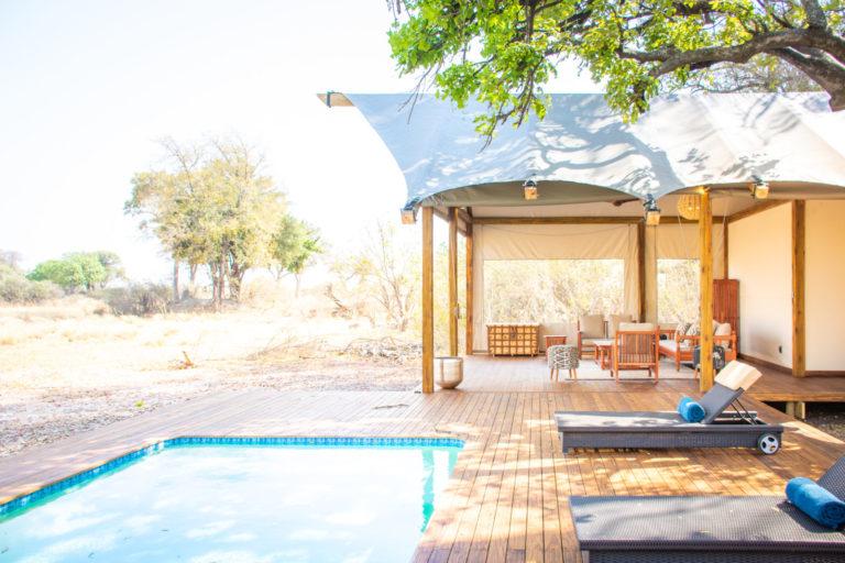 Kwara Camp pool area with sun loungers