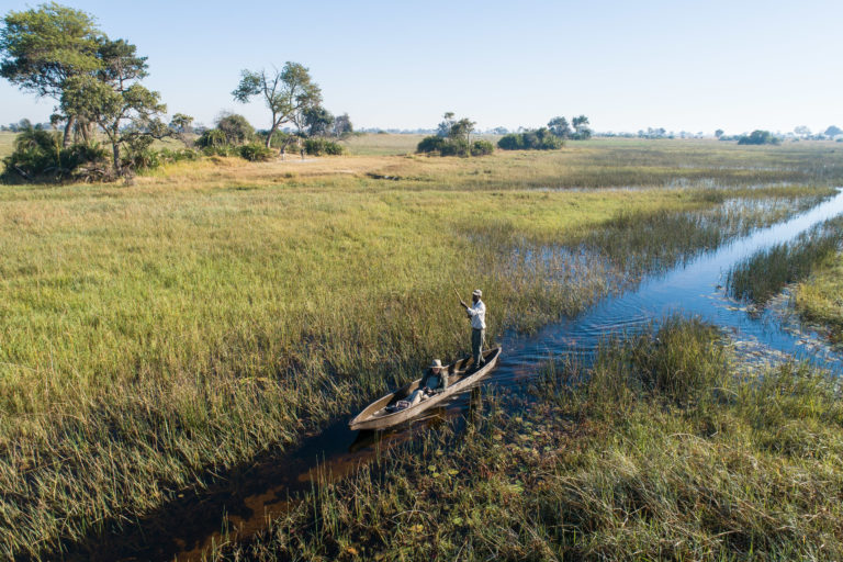 Setari Camp invites guests on a guided mokoro trip through the channels of the Okavango Delta
