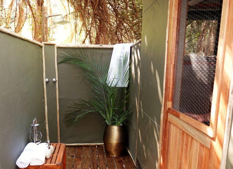 Tastefully decorated outside bathroom at Setari Camp