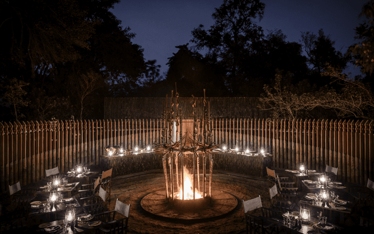 Some nights see the boma come to life for an atmospheric dinner at Xigera Safari Lodge
