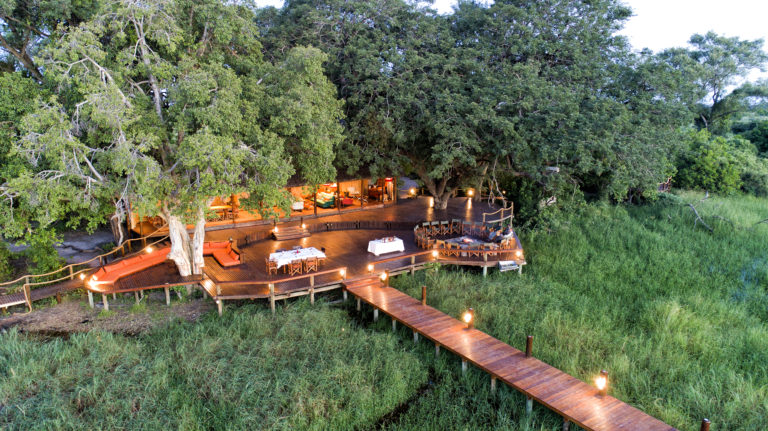 Main area at Mapula Lodge with wooden walkway leading off it