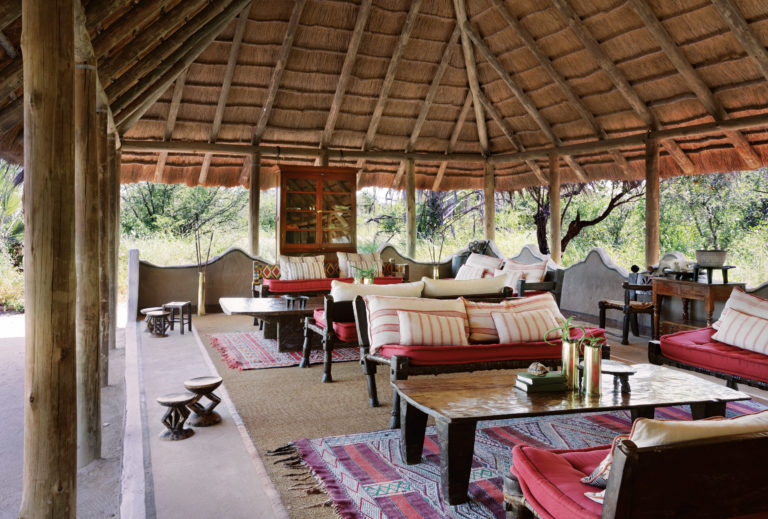 African styled furniture in the main lounge area at Camp Kalahari