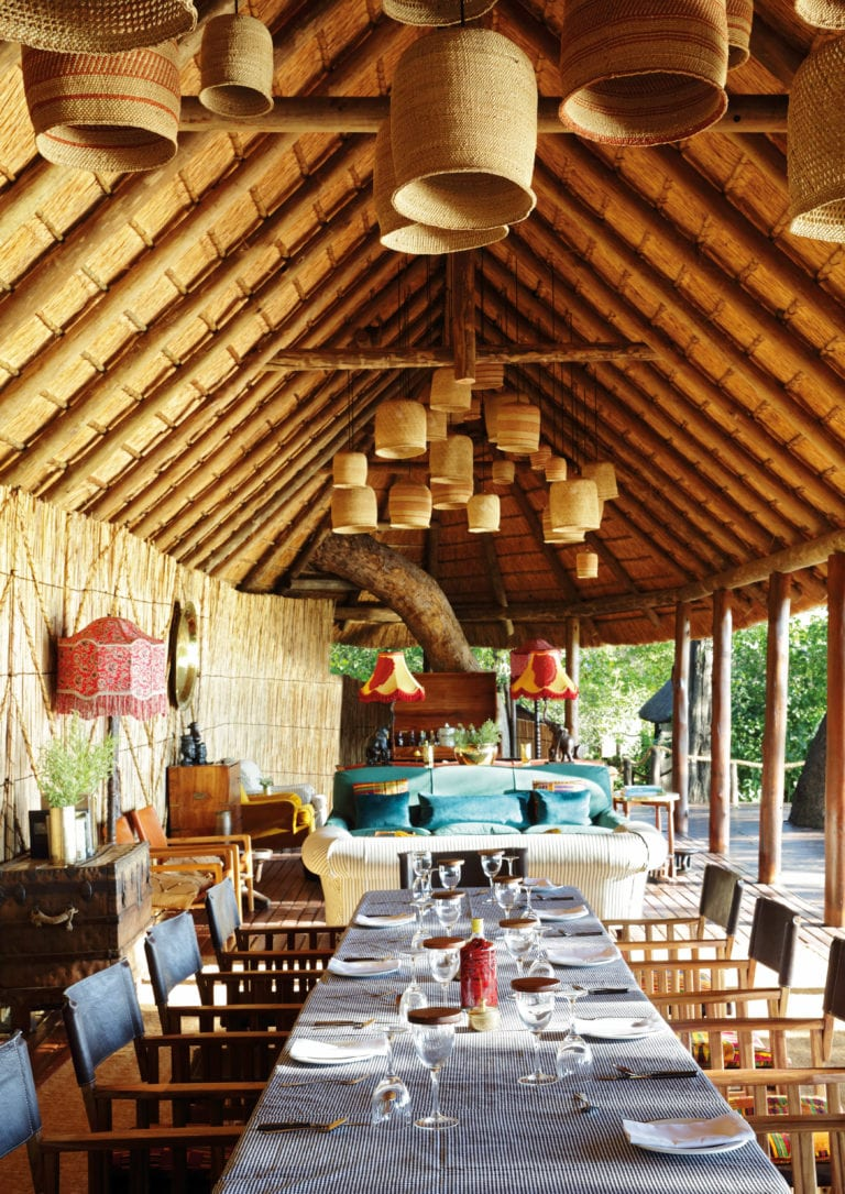 Dining room table set up under thatch at Mapula Lodge