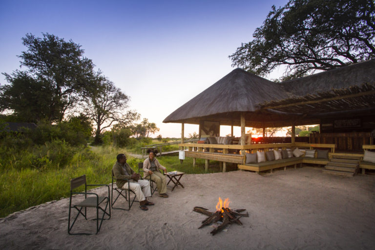 Little Sable Camp guests relax in the sunken lounge with fire pit