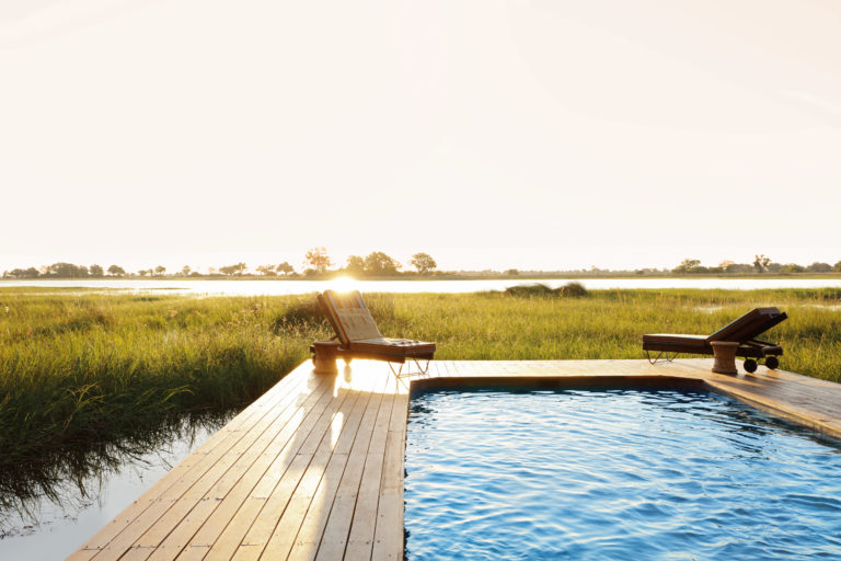 The swimming pool and deck at Mapula Lodge enjoy extensive views