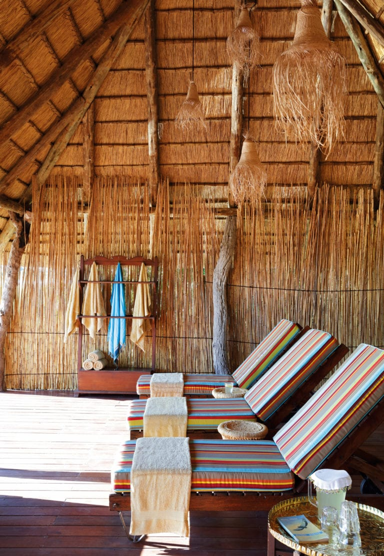 Sun loungers under thatch at Mapula lodge