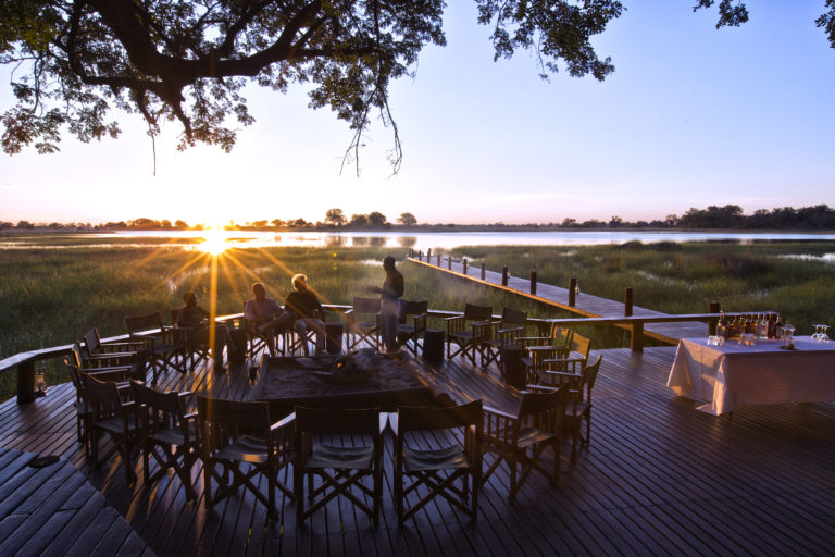 Sunset drinks on the wooden deck at Mapula Lodge