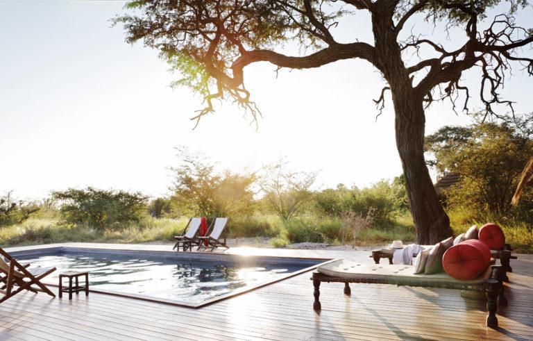 The inviting swimming pool deck at sunrise at Camp Kalahari