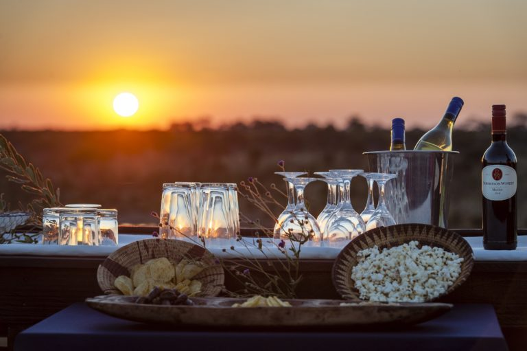 Sundowners and snacks with picturesque sunset at Skybeds