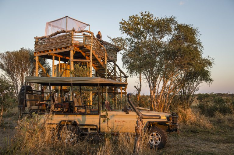 Safari vehicle and Skybeds sleepout deck in the Northern section of the Khwai Private Reserve
