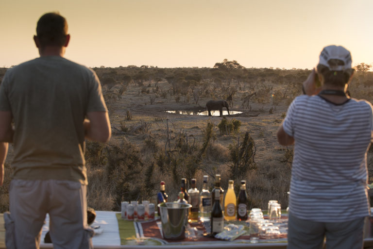 Sundowner view of elephant at waterhole at Khwai Skybeds
